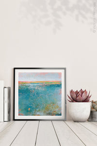 "Teal abstract ocean art ""Admiral Straits,"" digital print by Victoria Primicias, decorates the shelf."
