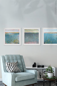 "Teal abstract beach art ""Admiral Straits,"" digital print by Victoria Primicias, decorates the living room."