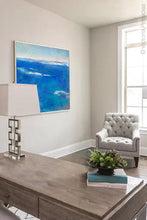 "Load image into Gallery viewer, Coastal blue abstract beach wall art ""Aegean Crossing,"" downloadable art by Victoria Primicias, decorates the office."