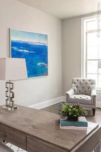 "Coastal blue abstract beach wall art ""Aegean Crossing,"" downloadable art by Victoria Primicias, decorates the office."