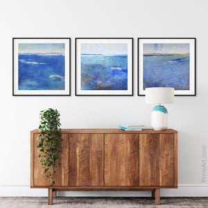 "Coastal blue abstract beach wall art ""Aegean Crossing,"" downloadable art by Victoria Primicias, decorates the entryway."
