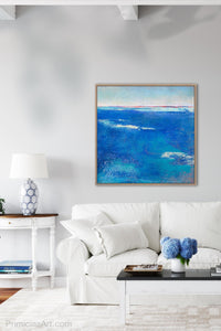 "Coastal blue abstract beach art ""Aegean Crossing,"" digital print by Victoria Primicias, decorates the living room."