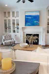 "Coastal blue abstract seascape painting""Aegean Crossing,"" downloadable art by Victoria Primicias, decorates the living room."
