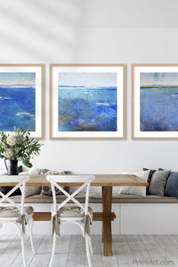 "Coastal blue abstract seascape painting""Aegean Crossing,"" downloadable art by Victoria Primicias, decorates the dining room."