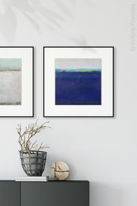 "Navy blue abstract beach wall decor ""After Hours,"" digital print by Victoria Primicias, decorates the entryway."