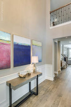 "Load image into Gallery viewer, Navy blue abstract beach wall decor ""After Hours,"" digital print by Victoria Primicias, decorates the foyer."
