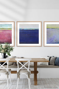 "Deep blue abstract coastal wall art ""After Hours,"" metal print by Victoria Primicias, decorates the dining room."