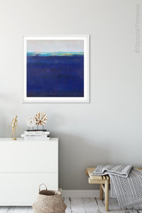 "Deep blue abstract coastal wall decor ""After Hours,"" wall art print by Victoria Primicias, decorates the entryway."