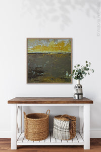 "Gold and brown abstract coastal wall art ""Afternoon Delight,"" canvas print by Victoria Primicias, decorates the entryway."