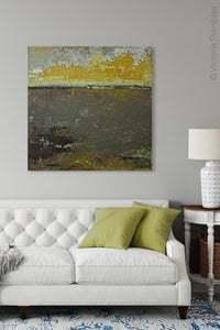 "Gold and brown abstract landscape art ""Afternoon Delight,"" giclee print by Victoria Primicias, decorates the living room."