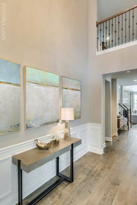 "Zen muted abstract seascape painting ""Alabaster Sands,"" downloadable art by Victoria Primicias, decorates the foyer."