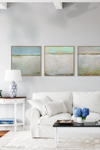 "Zen muted abstract seascape painting ""Alabaster Sands,"" downloadable art by Victoria Primicias, decorates the living room."