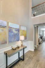 "Load image into Gallery viewer, Bright landscape painting ""Amalfi Sound,"" downloadable art by Victoria Primicias, decorates the entryway."