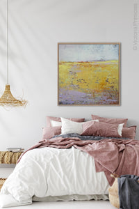 "Bright landscape painting ""Amalfi Sound,"" digital art by Victoria Primicias, decorates the bedroom."