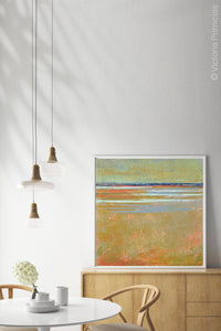 "Zen abstract beach wall art ""Amber Keys,"" digital print by Victoria Primicias, decorates the dining room."