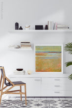 "Load image into Gallery viewer, Golden abstract beach wall decor ""Amber Keys,"" metal print by Victoria Primicias, decorates the office."