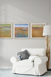 "Golden abstract coastal wall art ""Amber Keys,"" wall art print by Victoria Primicias, decorates the living room."