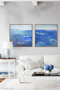 "Blue abstract coastal wall art ""Arctic Tidings,"" wall art print by Victoria Primicias, decorates the living room."
