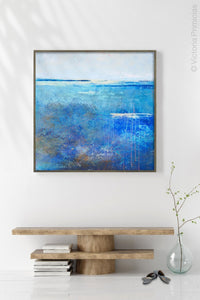 "Blue abstract beach wall decor ""Arctic Tidings,"" metal print by Victoria Primicias, decorates the entryway."
