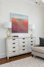 "Load image into Gallery viewer, Square abstract landscape art ""Azalea Coast,"" downloadable art by Victoria Primicias, decorates the living room."