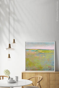"Yellow green landscape painting ""Bellini Fields,"" digital art by Victoria Primicias, decorates the dining room."