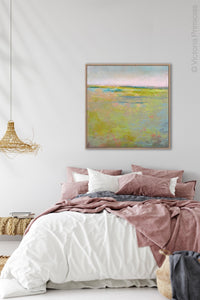 "Yellow green abstract landscape painting ""Bellini Fields,"" digital print by Victoria Primicias, decorates the bedroom."
