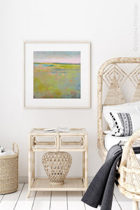 "Yellow green abstract landscape painting ""Bellini Fields,"" digital download by Victoria Primicias, decorates the bedroom."