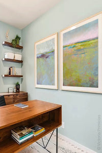 "Yellow green landscape painting ""Bellini Fields,"" downloadable art by Victoria Primicias, decorates the office."