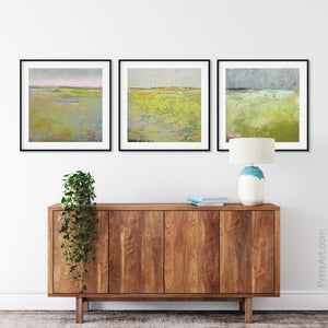 "Yellow green abstract landscape art ""Bellini Fields,"" digital art landscape by Victoria Primicias, decorates the entryway."