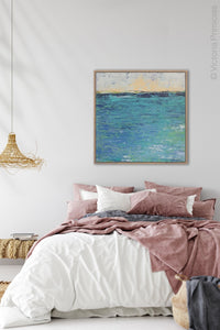 "Blue abstract seascape painting""Beryl Basin,"" printable wall art by Victoria Primicias, decorates the bedroom."