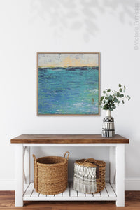 "Blue abstract beach art ""Beryl Basin,"" printable wall art by Victoria Primicias, decorates the hallway."