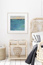 "Load image into Gallery viewer, Blue abstract beach art ""Beryl Basin,"" printable wall art by Victoria Primicias, decorates the bedroom."
