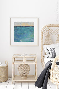 "Blue abstract beach art ""Beryl Basin,"" printable wall art by Victoria Primicias, decorates the bedroom."