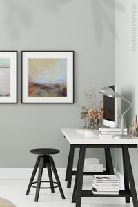 "Coastal abstract landscape art ""Blue Promise,"" digital print by Victoria Primicias, decorates the office."