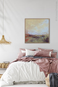 "Coastal abstract landscape art ""Blue Promise,"" digital print by Victoria Primicias, decorates the bedroom."