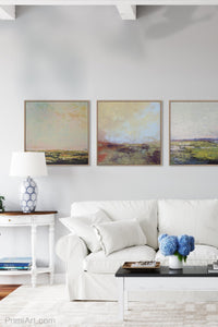"Coastal abstract landscape art ""Blue Promise,"" digital print by Victoria Primicias, decorates the living room."