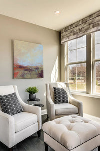 "Unique abstract landscape painting ""Blue Promise,"" giclee print by Victoria Primicias, decorates the living room."