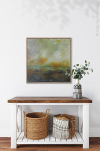 "Unique abstract landscape art ""Blushing Silence,"" digital download by Victoria Primicias, decorates the entryway."