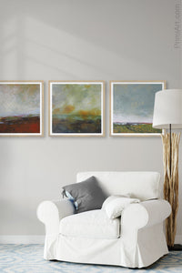 "Unique abstract landscape art ""Blushing Silence,"" digital download by Victoria Primicias, decorates the living room."