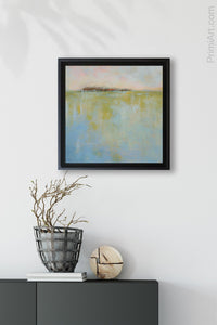 "Serene watery seascape ""Borrowed Time"" decorates an entry wall above a console table."