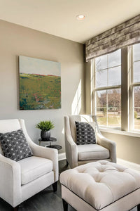 "Modern abstract landscape art ""Brassy Pastures,"" downloadable art by Victoria Primicias, decorates the living room."