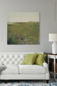 "Modern abstract landscape art ""Brassy Pastures,"" digital print by Victoria Primicias, decorates the living room."