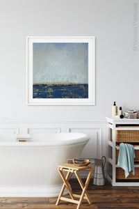 "Indigo blue abstract seascape painting ""Broken Rules,"" digital download by Victoria Primicias, decorates the bathroom."