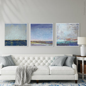 "Indigo blue abstract beach wall art ""Broken Rules,"" digital download by Victoria Primicias, decorates the living room."