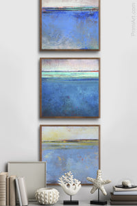 "Blue abstract beach art ""Carolina Shores,"" metal print by Victoria Primicias, decorates the hallway."
