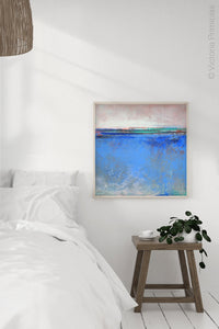 "Blue abstract beach wall art ""Carolina Shores,"" fine art print by Victoria Primicias, decorates the bedroom."
