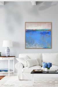 "Blue abstract beach art ""Carolina Shores,"" metal print by Victoria Primicias, decorates the living room."