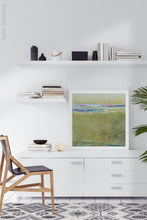 "Load image into Gallery viewer, Yellow green abstract ocean painting ""Cayo Verde,"" digital print by Victoria Primicias, decorates the office."