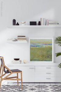 "Yellow green abstract ocean painting ""Cayo Verde,"" digital print by Victoria Primicias, decorates the office."