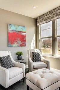 "Colorful abstract landscape art ""Cerise Harbor,"" digital print by Victoria Primicias, decorates the living room."